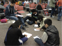 Misty, finger on text, in January 2014, assisting a sonnet group at Franklin High School during the YSW Senior Humanities Sonnet lecture/workshop.
